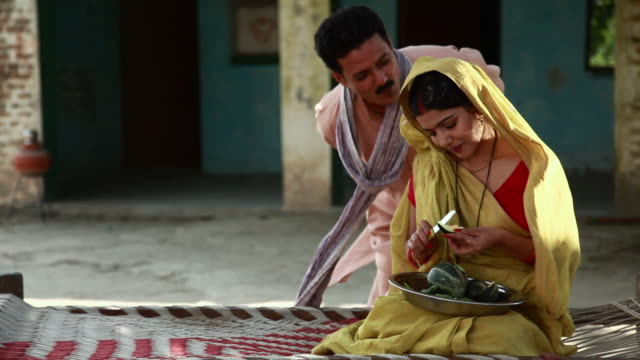 Man giving bangle to his wife
