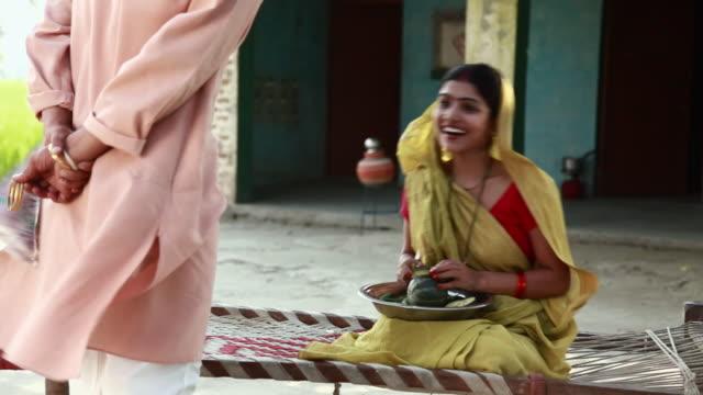 man giving bangle to his wife  - dhoti video stock e b–roll