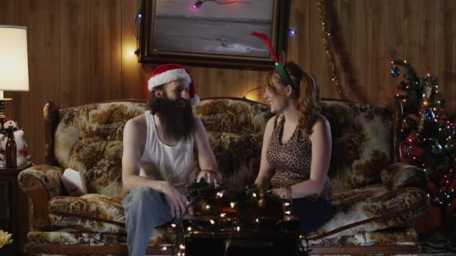 ms man giving christmas gift to woman in living room / orem, utah, usa - orem utah stock videos & royalty-free footage