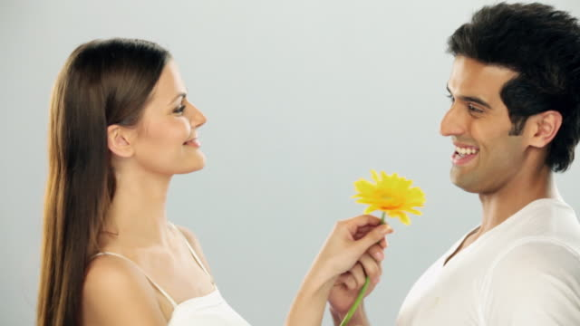 Man giving flower to his girlfriend