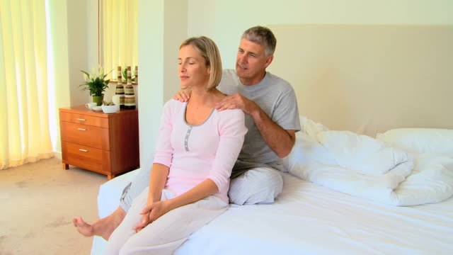man giving his wife a massage / cape town, western cape, south africa - nightdress stock videos & royalty-free footage