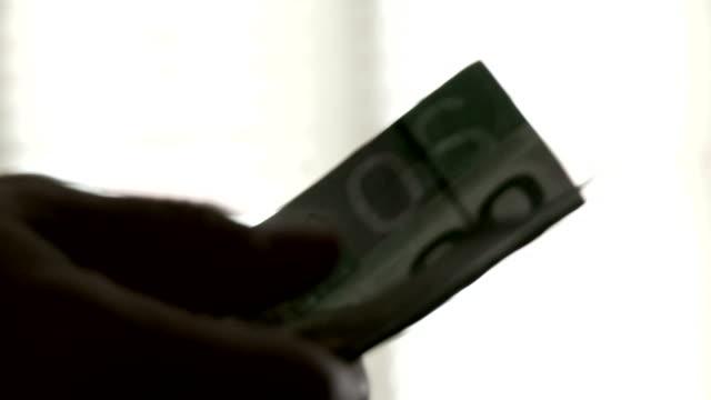 CU of man giving money followed by handshake