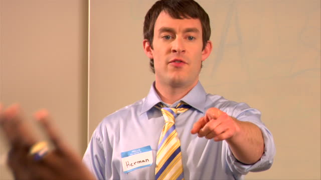 CU, Man giving presentation in conference room