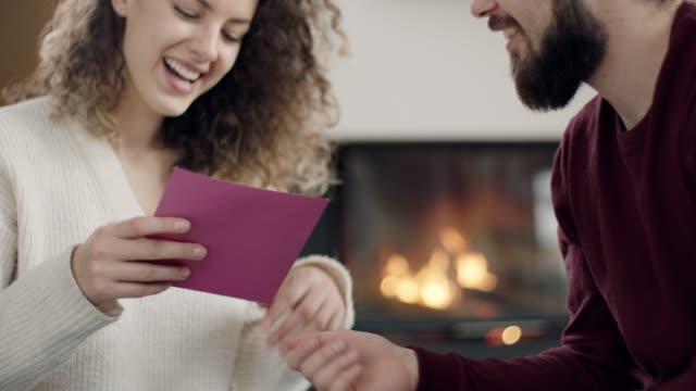 man giving purple envelope to woman - envelope stock videos & royalty-free footage