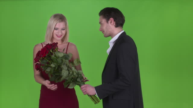 hd: man giving roses to his girlfriend - flirting stock videos & royalty-free footage