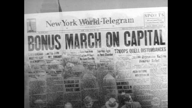 Man giving speech during Bonus March / newspaper headline about march / soldiers in street during march Bonus March on July 28 1932 in Washington DC