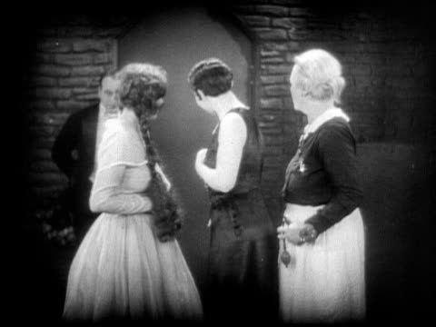 ms, b&w, man giving woman flowers in cabaret dressing room, 1920's  - social grace stock videos & royalty-free footage