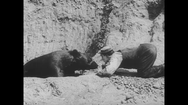 1923 man (buster keaton) goes bear hunting - 1923 stock videos & royalty-free footage