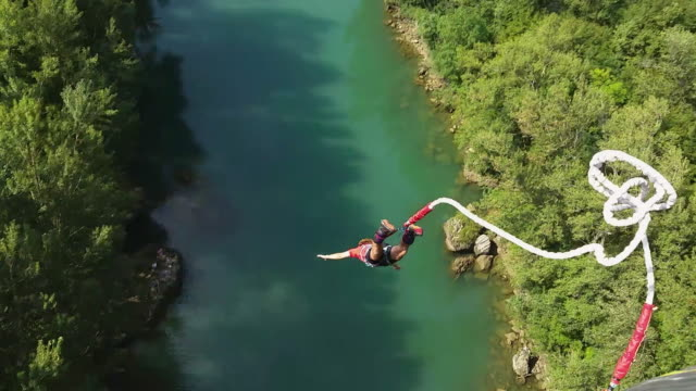 td man goes bungee jumping - tilt stock videos and b-roll footage