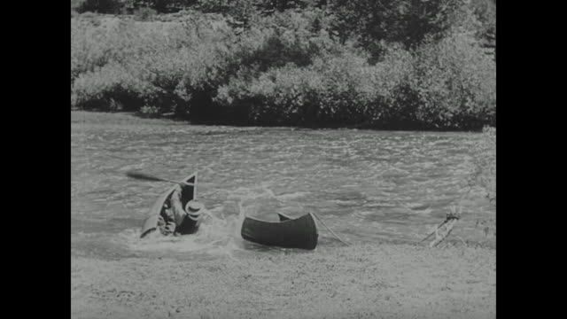 1923 man (buster keaton) goes canoeing in a river but the canoe breaks apart - 1923 stock videos & royalty-free footage