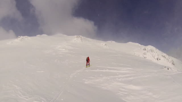 a man goes cross-country skiing on a very windy day. - slow motion - ski jacket stock videos & royalty-free footage