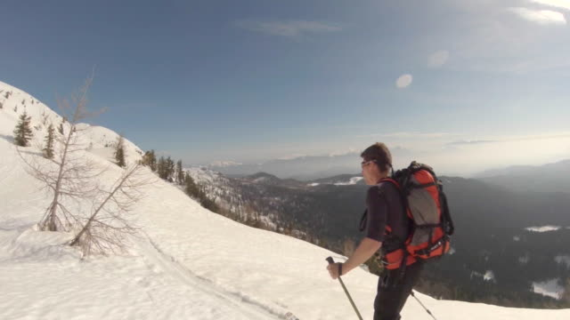 a man goes cross-country skiing. - slow motion - cappotto invernale video stock e b–roll