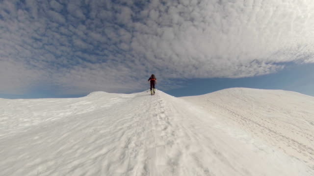 a man goes cross-country skiing. - slow motion - one man only stock videos & royalty-free footage