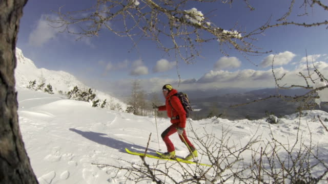 a man goes cross-country skiing. - wintermantel stock-videos und b-roll-filmmaterial