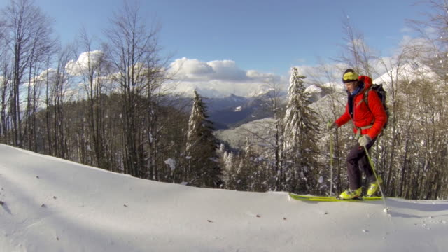 a man goes cross-country skiing. - cappotto invernale video stock e b–roll