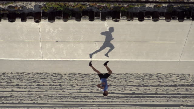 A man going for a run by the beach. - Super Slow Motion - filmed at 240 fps