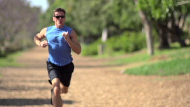 a man going for a run.  - super slow motion - filmed at 240 fps - one mid adult man only stock videos & royalty-free footage