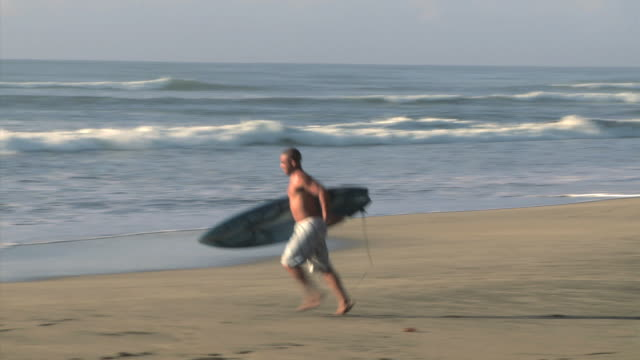 man going to surf