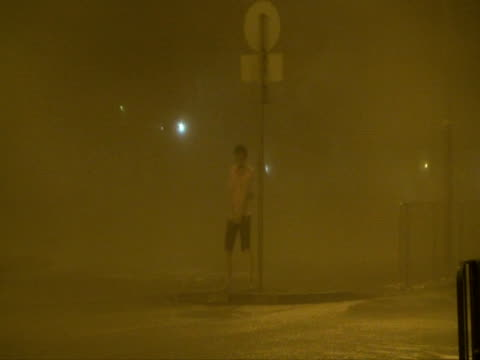 man grabbing pole in hurricane wind rain, typhoon koppu, hong kong on night of 14th sept 2009. with audio. - gale stock videos and b-roll footage