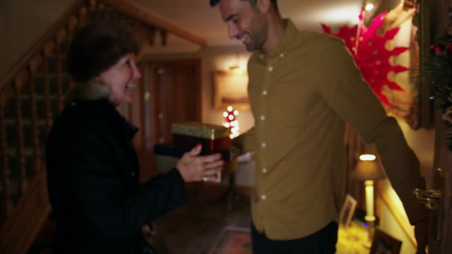 man greeting mother - christmas decoration stock videos & royalty-free footage