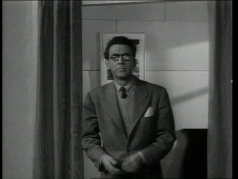 1943 MS Man greets wife wearing new, thick eyeglasses