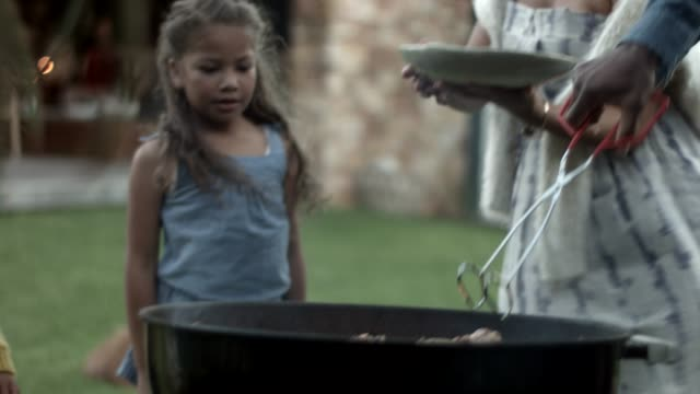man grilling meat in backyard - grilled stock videos & royalty-free footage