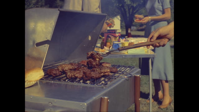MS Man grilling meat on barbecue / United States