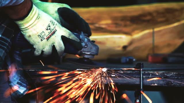 man grinding in his workshop - workbench stock videos & royalty-free footage