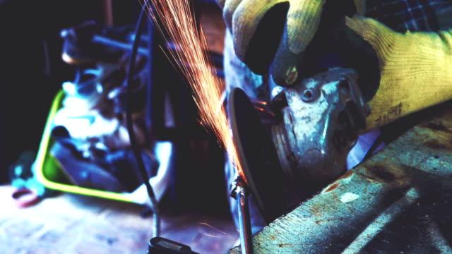 Man grinding in his workshop