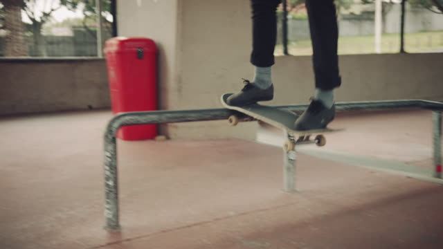 Man grinding over rail with skateboard