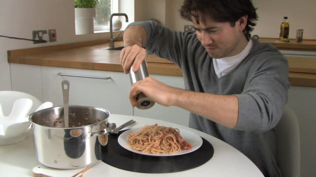 man grinding pepper over pasta, uk - spaghetti bolognese stock videos & royalty-free footage