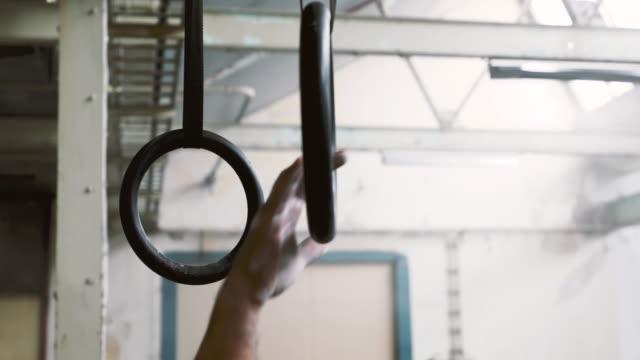 man gripping gymnastic rings - gymnastic rings stock videos & royalty-free footage