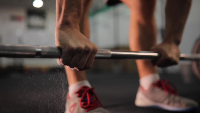 man gripping the barbell - health club stock videos & royalty-free footage