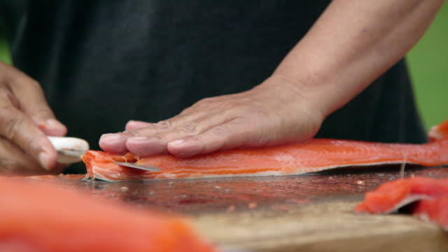 cu of man gutting salmon - trout stock videos and b-roll footage