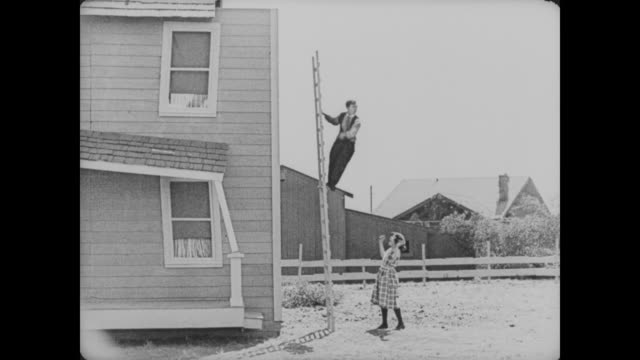 1920 man (buster keaton) halls a close call while climbing down a ladder - ladder stock videos & royalty-free footage