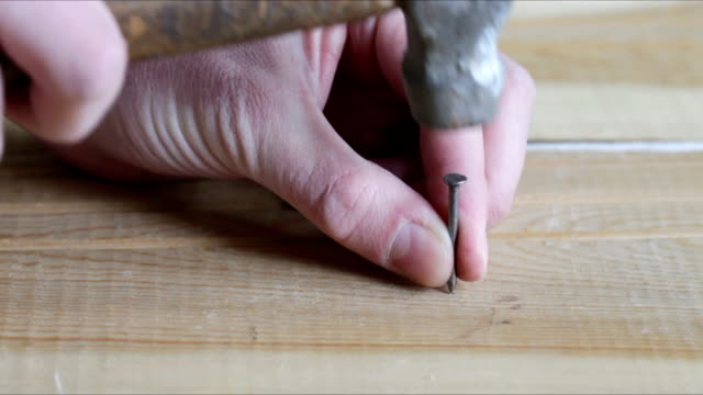 man hammering nail - hammer stock videos and b-roll footage