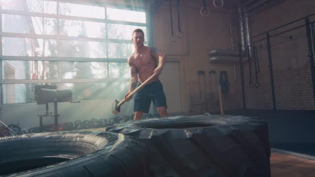 man hammering on big tire - cross training stock videos & royalty-free footage