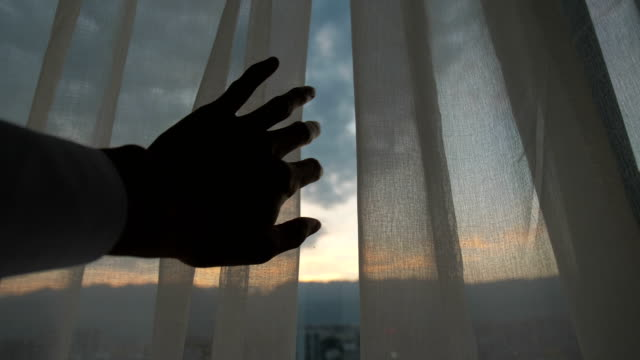 man hand open curtain - light natural phenomenon stock videos & royalty-free footage