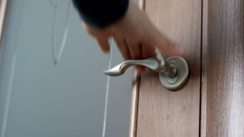man hand open door handle indoors shot on red camera - opening stock videos & royalty-free footage