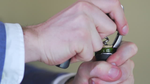 man hand open red wine slow motion - bottle opener stock videos & royalty-free footage