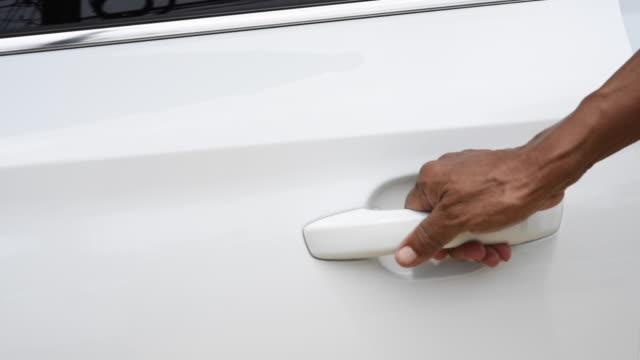 man hand open white door car - car door stock videos & royalty-free footage