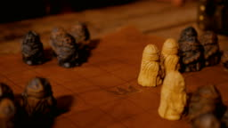 Man hand placing figures for medieval popular strategy board game - tafl