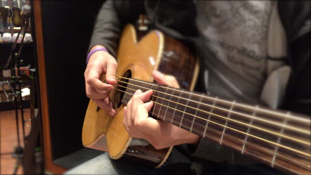 man hand playing guitar - fretboard stock videos and b-roll footage