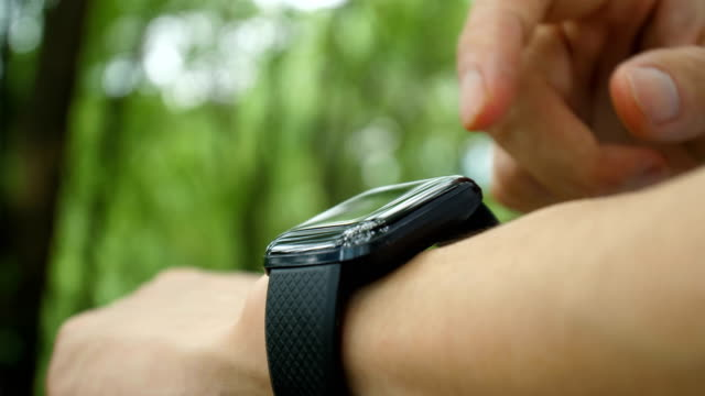 man hand touching smart watch - joint body part stock videos & royalty-free footage