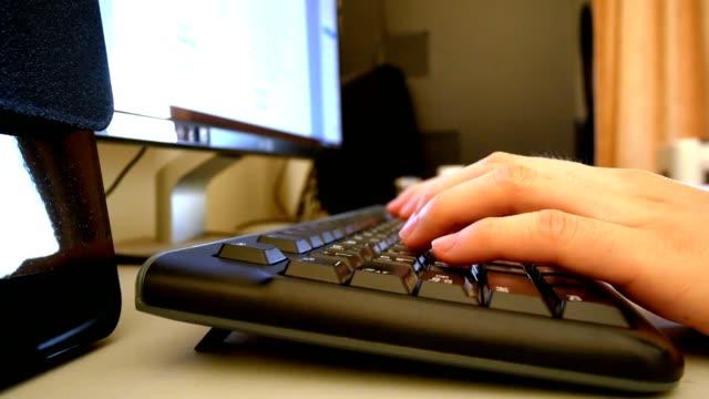 man hand typing working on desktop computer keyboard - close up view