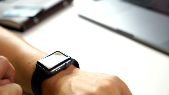 man hand using smart watch to connect with people in social network