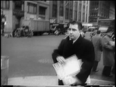 b/w 1958 man handing out flyers on street corner during nyc garment workers strike / newsreel - fackförbund bildbanksvideor och videomaterial från bakom kulisserna