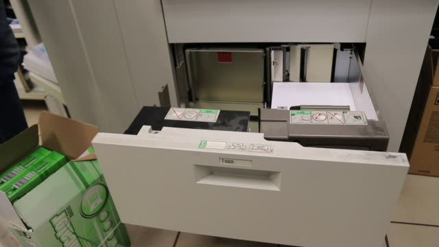 man hands adding paper to photocopier machine - fax machine stock videos & royalty-free footage
