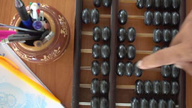Man hands are operating abacus