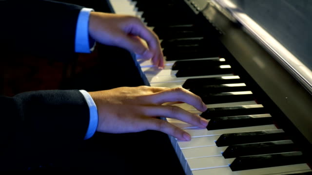 HD CU: Man Hands on the Keyboard Playing a Piano
